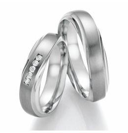geschwungene Hochzeitsringe aus Titanium, Partnerringe mit Brillanten