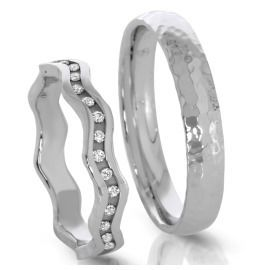 orginelle Trauringe aus 500/- Palladium in Wellenform & Diamanten