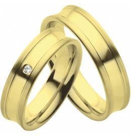 schöne kombinierte Trauringe aus Gelbgold mit Diamant